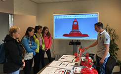 Students view the innovative broiler pan the Valenta